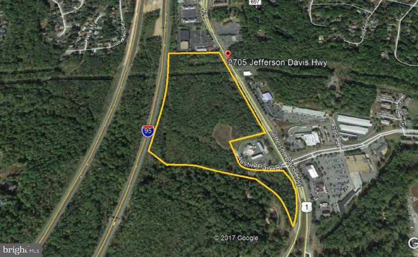 28.88 ACRES ZONED B-2 COMMERCIAL With Remarkable visibility with over 1,500 and 1,900 feet of frontage on I-95 and Rt 1 Hwy, respectively.  Property was approved for a mixed use project with a total building area of 410,798 square feet.  Significant engineering work has been completed on the site.