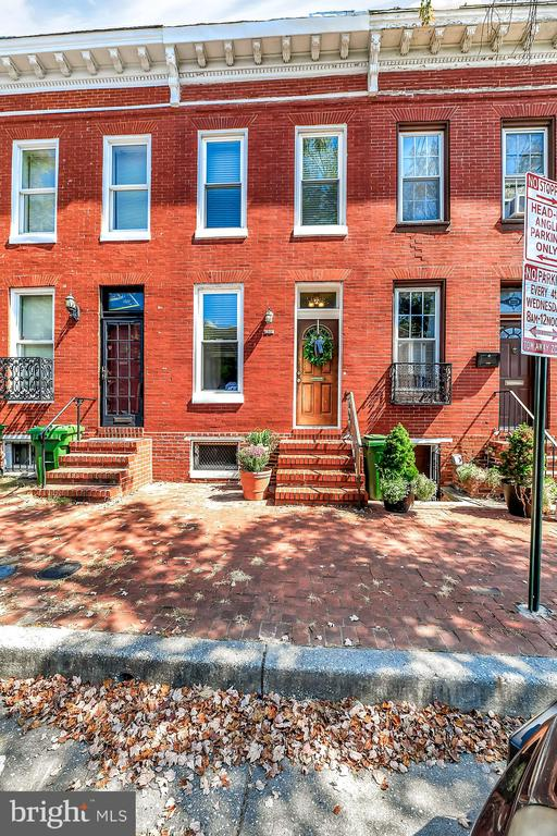 """Welcome to Barre Circle- one of Baltimore's most charming and historic neighborhoods! Many interesting renovations and gardens can be found in this desirable neighborhood; where many houses have big back yards and the neighborhood has two large common park areas. Where no two homes are the same, this rarely available 2 bed 2 full bath house boasts original hardwood floors, exposed brick, tons of natural light and PARKING! Two spacious bedrooms, open concept kitchen/dining area and an unfinished basement serves as the perfect """"man cave"""". Newly painted and brand new carpets, plus new electrical, plumbing and HVAC.  Easy access to major highways and within walking distance of stadiums, downtown attractions, and UM medical campus. Situated on a quiet, tree lined, brick sidewalk street and eligible for Live Near Your Work and other Buying into Baltimore grant incentives!"""