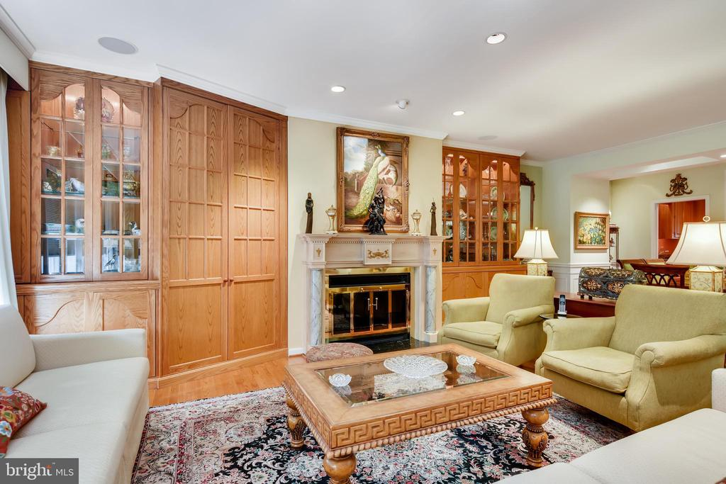 Don't miss this stunning town home in Roland Park North. There is over 3000 sq ft of finished space- From the large eat-in kitchen with gorgeous cherry cabinets, granite counters, and ceramic tile floor to the dining room/living room combined space featuring custom built-in cabinets and wood burning fireplace. Other important features are the hardwood floors throughout, crown moldings, vaulted ceilings,  skylights, finished basement with half bath, and a large loft which can either be a 4th bedroom or playroom with its own full bath, a two car garage, a front patio, and a back deck with shed. Tons of storage! Conveniently, yet privately located~ you will love coming home every day!