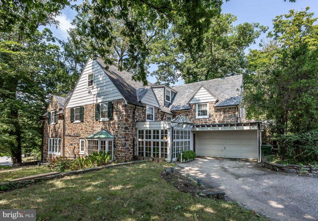 Motivated Seller !  A Special spot in Baltimore!  Stately Stone Home on a hill over looking the lakes in Homeland.  c. 1929 - F. Edward Tormey - Architect.  Comfortably elegant floor plan IDEAL for entertaining.  OPEN kitchen to impressive sun flooded breakfast/dining area.  Wine cellar, fitness area & deep 2 car attached garage with covered entry to mudroom and butlers pantry.  3 zone HVAC.  Stone terrace with sylvan view of the lakes.