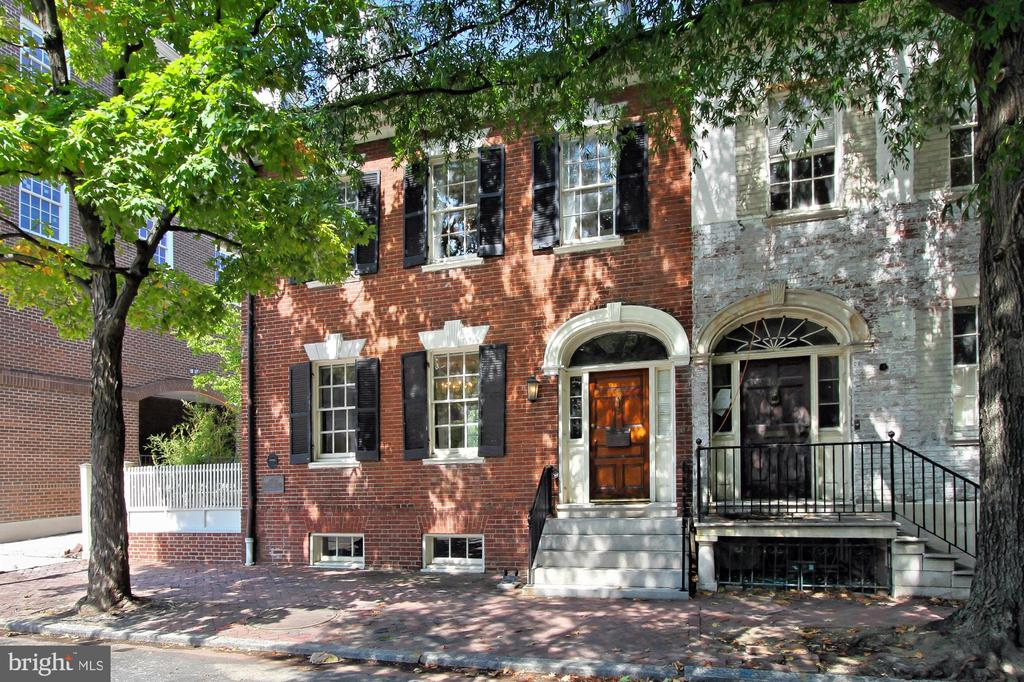 "This gracious semi-detached Federal style brick row home was built in the late 1700s and was the home of Robert E. Lee's father General ""Light Horse Harry"" Henry Lee in the early 1800s--who was the ninth Governor of Virginia and famous for delivering President George Washington's eulogy. The home is zoned RM which allows for a myriad of residential/commercial uses.  There are currently seven bedrooms, four full and one half baths, three kitchens, three laundry closets and seven fireplaces.  A pebble driveway leads to ample parking in the rear of the home as well as a side garden adorned with fruit trees and grass lawn.  Centrally located in the heart of Old Town's historic district on Cameron nearest to cross street N Washington--a direct commuting route into Washington, DC, Reagan National, the Pentagon and new Amazon HQ2.  Numerous recent upgrades include a newer roof, HVAC as well as updated baths and kitchens.  Perfect for a residence/office combination or conversion back to a fabulous 4,200+ sq ft single family residence."