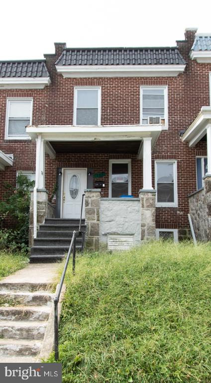 """Five Single Family Investment Properties in the """"Winston Govans and Belair Parkside"""" Areas of Baltimore City. Online Auction Only! Bidding begins Sunday, October 6th and closes Friday, October 11th Beginning at 10:00am. Tenant Occupied Porchfront Brick Townhome in the """"Winston-Govans"""" Area of Baltimore City **Current Scheduled Annual Gross Rent Of $15,564**"""