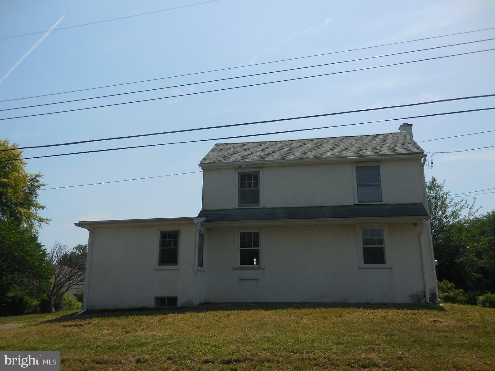 Rural setting in Lower Oxford Township surrounded by farmland. This 2-story Farmhouse, deeded 1865 and built in the 1700's, has old-world charm. Open porch, living room, dining room, kitchen, bedroom and full bath. Upstairs are 2 bedrooms. Laundry/mud room, full basement, and oil heat.