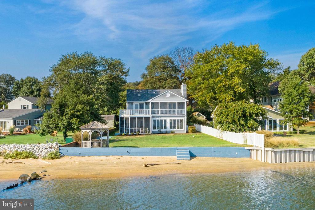 1224 River Bay Road has panoramic Chesapeake Bay views, across to Gibson Island in one direction and the Eastern Shore in the other. The spacious yard includes a gazebo for picnics and steps down the seawall to the beach. An open floor plan means maximum water views. Enjoy the screened porch on the main level or the upper level deck. The super master bedroom suite upstairs includes a waterside porch, just-remodeled bathroom, and walk-in closet. Two more bedrooms, one of which has a waterside balcony, share a hall bath. Laundry is located on the second floor. A 4th bedroom and full bath is on the main level. This home is located in Cape St. Claire, which offers a clubhouse, marina, boat ramp, and playground. ~Schools for this property include Cape St. Claire elementary, Magothy River middle, and Broadneck high school. Take the LIVE VIDEO TOUR!