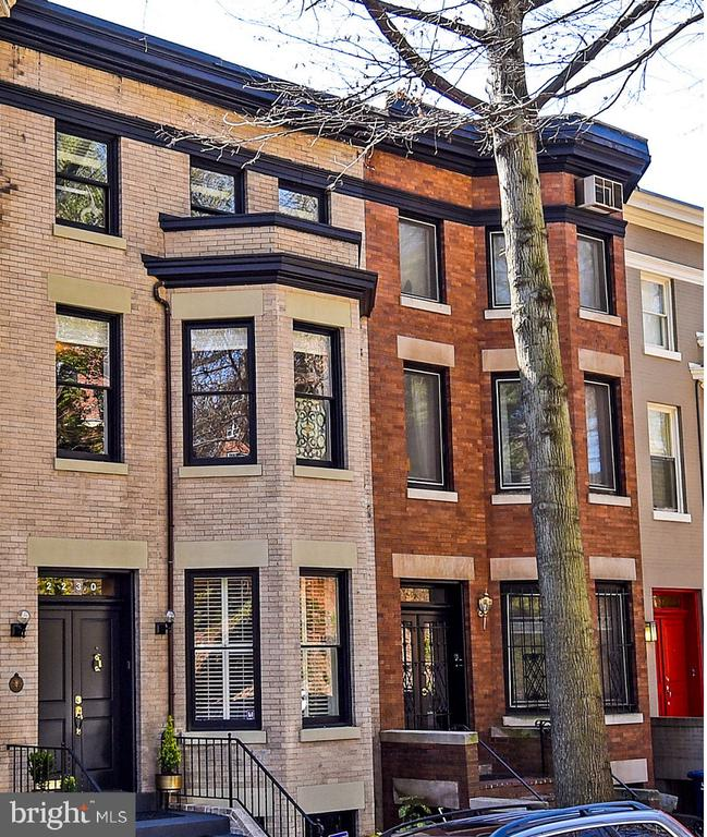 Elegant historic brick town home on quiet street near Embassy Row, in prestigious Kalorama. Amazing location with great Walk Score: just five minutes to fine dining, the Philips Museum, the Cosmos Club, Mitchell Park, and the Dupont Circle Metro & Farmers Market. The light-filled home combines traditional finishes with modern architectural touches. Lovely outdoor spaces on each level seamlessly blend indoor and outdoor living. This 3700 square-foot home features over $370,000 in upgrades. On the first floor, pass through the foyer to the drawing room with a fireplace, and then on to the modern kitchen, Viking and Sub Zero appliances, then to the great room with built-in cabinets, and finally to the sun room with a breakfast nook and view of the brick patio, deck, and mature trees. The second floor has been converted into an expansive master bedroom suite with a large walk-in closet and make-up room, two luxurious bathrooms, a walk-out balcony, and a large sitting room with fireplace, perfect for recreation or entertainment. The third level bedroom suite, with attached full bath and access to the roof deck and tree canopy, defines an elegant oasis. Roof deck has amazing night views of Rosslyn. The lower level is fully-finished with a bedroom, full bath, kitchenette, and a private entrance. For the health conscious: whole house Culligan water filtration and germ destroying internalized ultraviolet A/C systems.