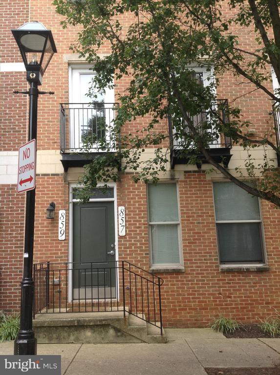 Spacious condominium in downtown Baltimore. Brick front, open living and dining room, 3 bedrooms, 2-1/2 baths, eat in kitchen, private balcony off master bedroom and living room, wood floors on all levels, and 1 car garage. Walking distance to Baltimore Harbor, Little Italy, Orioles Camden Yards, Ravens Stadium, John Hopkins University/Hospital, University of Maryland Medical School, MARC trains and Baltimore City public transportation. Penn Station and Highways. This is a short sale and requires third party approval. Sold As-Is.