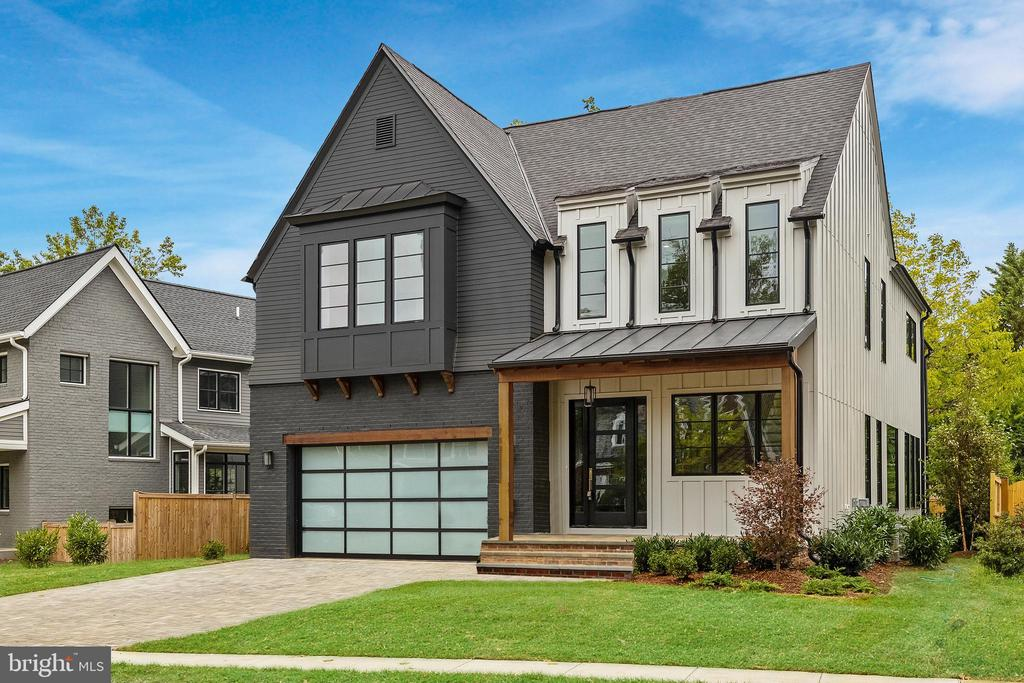 Situated a block-and-a-half from Lyon Village Park on one of Central Arlington's most prized tree-lined streets, is the stunning new Urban Tudor Design by Brush Arbor. On a uniquely large lot able to accommodate a rare two-car garage, and elevator shaft to all levels, 2 outdoor entertaining spaces and yard in Lyon Village, the award-winning builder has crafted a modern gem in the coveted historic neighborhood, . This refined 5500 SF+/- home offers an unparalleled standard of luxury with 3 stories, 5 bedrooms, 5 full and 2 half bathrooms. 3127 18th St North reflects the apex of today~s ultra-luxury East Coast living. Intricate details intertwine with modern amenities while offering the best of indoor and outdoor living spaces, featuring a striking painted brick and combination facade in charcoal and black with the statement pop of black steel windows.True craftsmanship and impeccable attention to detail is revealed throughout the interior. Elegance and light envelope you in every room, reflected in the top-quality, meticulously-designed elements of high architectural ceilings, hand-milled wide plank white oak floors, superlative aged brass and gold finishes and designer fixtures including lighting by CurreyCO and VisualComfort. Generous black floor-to-ceiling gallery, picture, and framed Jeld Wen windows fill the home with abundant natural light. A grand entry foyer and striking, clean lines of a stunning staircase with paneled three-story wall and stunning light fixtures welcomes you into the garden level of the home. Beyond the entry is a library with painted built-ins, gourmet chef's kitchen open to a dining room and family room which flows out to the rear garden terrace and porch. The sleek gourmet kitchen is appointed as any chef would want, with top-of-the-line appliances and superior finishes such as; floor to ceiling shiloh cabinetry, open wood shelving, designer lighting, pantry, and island with seating. Adjacent sits an open family room with a fireplace and wood-beamed ceiling as well as floor to ceiling glass windows and doors leading to the fully fenced rear garden terrace and porch presenting a stunning lanai linear outdoor fireplace for indoor/outdoor entertaining. Surrounding the garden terrace is a cedar fence and specimen plantings enhancing the privacy and ambiance while lounging by the outdoor fireplace and dining al fresco.The lower level is perfect for entertaining. An elegant recreation room with a sleek wet bar with pearl white melamine frameless cabinetry and delta matte black hardware, media built-in, a powder room, and guest suite. The upper level is the bedroom wing, featuring a master retreat, presenting a deluxe master bedroom, magnificent his and hers master closets, spa-like private bathroom with dual sinks, standalone tub, walk-in shower and two water closets. The secondary bedrooms all boast full ensuite bathrooms. A laundry room with pedestal completes the upper level, and the home is designed with an optional elevator shaft. Each Brush Arbor home is individually designed and finished, specific to the lot and neighborhood. Unique to Brush Arbor are these added features: pre-wiring for generator, whole-house speakers, spray foam insulation, upgraded window package, pre-wire for electric drop-down screen on porch, laundry pedestals.~Don't miss your chance to own a 2019 Brush Arbor Design.