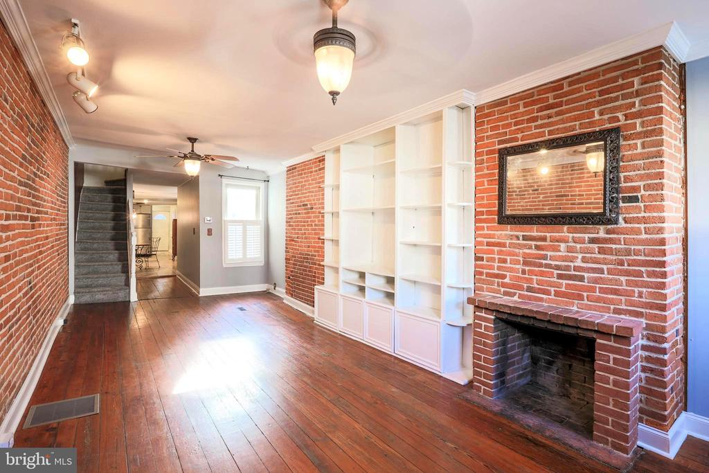 Old world charm meets modern updates in this beautiful 3 story home in convenient Fells Point location! Enjoy entertaining, grilling or just relax on your private rear patio. Original hardwood floors and exposed brick highlight the vintage aspect of this home. Tastefully remodeled kitchen includes marble counters, stainless steel appliances, tile floor & plenty of room for table space. Rare ability / option to choose your master bedroom with full bath on either the 2nd or 3rd level. Perfect opportunity to live close to downtown, Hopkins and all the city has to offer. Make your appointment today!
