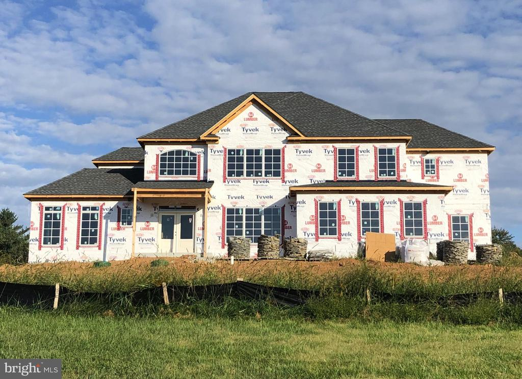 Under Roof!!! This is the last one! Gorgeous custom home ready for fall delivery. Pick out all of your own personalized finishes! Don't miss out!  This one is a knockout and priced under market at pre-construction pricing.