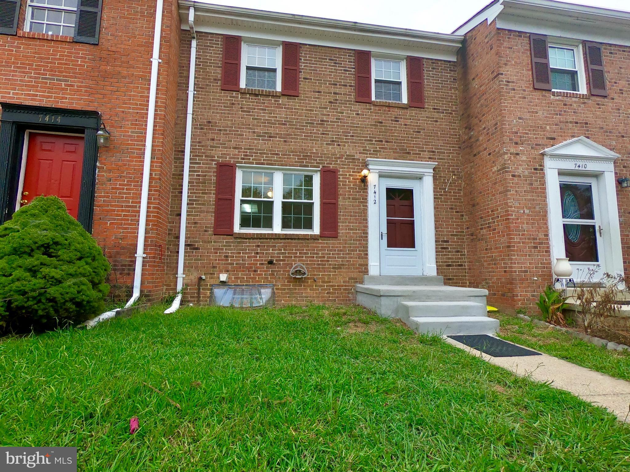 Great Location, 3 Level TH.Three Bedrooms with 2.5 Baths.    Many Improvements   New  flooring.  Walk-out Basement.