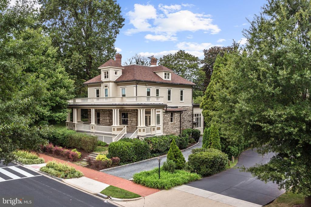 JUST LISTED! OPEN SUN 9/22 2-4PM! 1901 Victorian jewel of American University Park, Bethesda! Captivating facade with wrap-around porch and turret reveals bright and airy, expansive interior of nearly 5,000 SF. Formal LR & DR, Kit and large adjoining Fam rm w/ fireplace on main level, 5+BR/3BA up - all sun-drenched with serene, leafy views from nearly every window. Home to one of the original developers of AU Park, this historic & architecturally significant home has been meticulously maintained with many recent upgrades while preserving its historic character - 9.5/10' ceilings, stunning moldings & millwork, enchanting period details throughout! Terrific location walkable to shopping, restaurants, & transit of Friendship Heights & Tenleytown. (Adjacent 6,000 SF lot also available for purchase for $650,000).