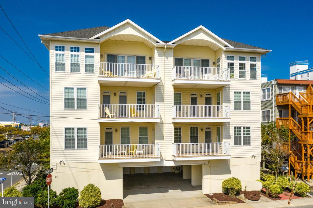 This is Ocean City's most unique and incredible opportunity of the year!  This luxury building consists of TWO Ocean Block TOWNHOMES steps from the beach. Own the entire building consisting of 2 luxurious 4BR/3BA/2HB  townhomes each with its own elevator that goes from the carport to the 3rd floor.  Each town home is 3400+ sq feet.  In total there are 8 bedrooms, 6 full and 4 half baths, 2 elevators, 2 full kitchens and covered parking for 6 cars.  This would be perfect for a large extended family or keep one unit and rent one (or both) units. Each townhome has 3 decks with breathtaking ocean and bay views.  You will be impressed with the spaciousness of these townhomes and the large living area.  The gourmet kitchens are sure to delight the cook in your family.  The top levels consist of hardwood floors and plenty of room for entertaining.  Both units are being sold fully furnished.  The current owner used one as a vacation home and rented the other for summer weekly rentals.  Tax records 10-104246 & 10-760119 being sold together.