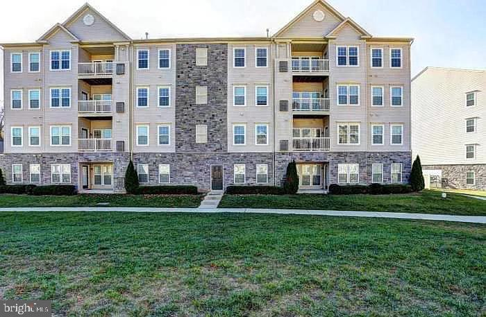 BEAUTIFUL condo in park-like setting! Move-in ready... Corian counters, custom  paint, crown molding, upgraded cabinets and bonus study/den leading to balcony. Two bedrooms on opposite sides of unit with their own bath make this private for guests or great roommate layout. Just over city line from Catonsville. Secure entry & elevator. Close to 695, 70, 95 and MARC train. Call to schedule. FHA