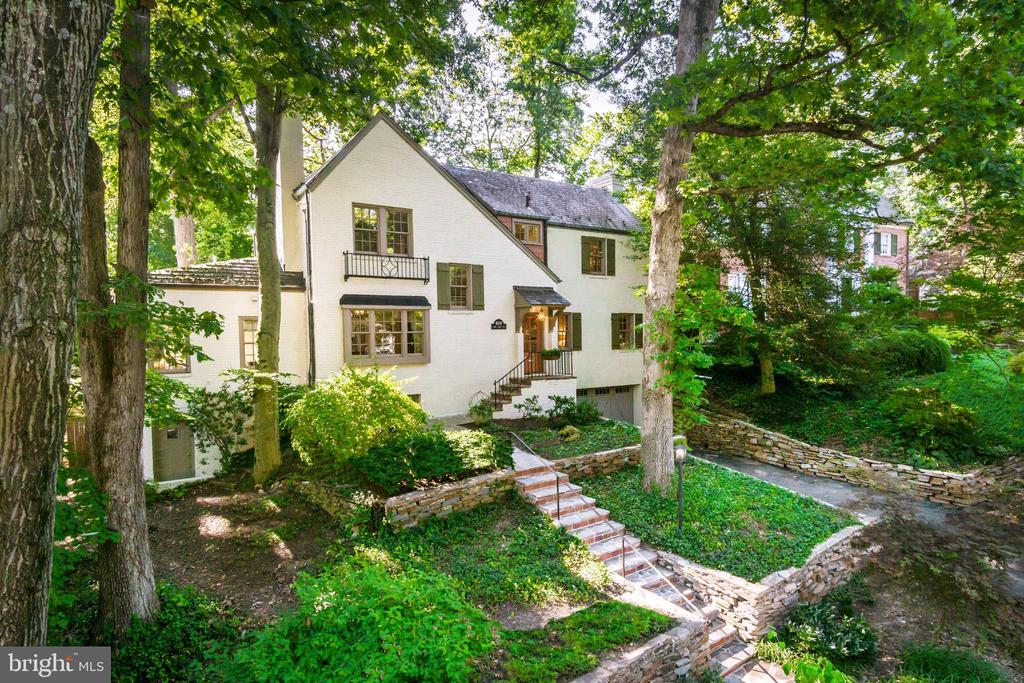 New Price & OPEN SUNDAY (Sept 22) 1-3PM! Fabulous Forest Hills home full of character and charm on a quiet street and quarter-acre lot! Three tastefully maintained levels include 4 BR, 3.5 BA, 2 fireplaces, Nest thermostat, granite kitchen w/ SS appliances including Viking Professional gas range; sunken family room, formal living and dining rooms accessing private fenced rear garden with screened porch! Finished Lower Level walks out to front garden w/ Rec Room, large custom laundry room, Guest Room, and 2-Car Garage! Must See!