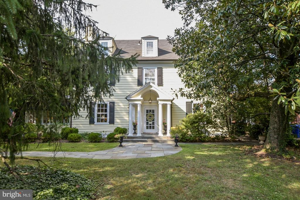This outstanding classic residence provides a lovely, grand oasis in the heart of Chevy Chase, with extensive grounds, gardens and pool, within easy walking distance of downtown Bethesda. Its spacious floor plan provides over 5800 square feet of elegantly finished space. A grand reception hall entrance welcomes guests and opens to embassy-sized Living and Dining Rooms. A Sunroom running the depth of the house offers windows overlooking the garden and opens to the spacious terrace. The large Chef's Kitchen provides Viking refrigerator and six-burner stove, plenty of cabinetry, and opens to the Breakfast Room. A lovely open staircase with large landing leads to the upper levels of the residence. The first upper level offers a lovely paneled Study and a light-filled hallway separating the four spacious Bedrooms, including a spacious Master Bedroom with MBA. A second Master Suite is located on the third floor of the home. This floor was created by the current owners, who lifted the ceiling and designed lovely new space - and can be used as an Office, Family Room or Guest Suite - including a foyer, a new Bathroom with large shower and double sinks, a sitting area with fireplace, and two large walk-in California closets. The interior of this residence offers tasteful built-ins, custom fixtures, beautiful hardwood floors, soaring 10 and 11 foot ceilings and rich millwork trim. The oversized 18,000 square foot property provides exceptionally lovely space for outdoor enjoyment, including a large flagstone terrace, mature gardens, a large pool and detached garage. The residence enjoys a private setting with easy parking along Hillcrest Place and is positioned next to the Chevy Chase Club. The driveway for the two-car detached garage is entered from the side street; Hillcrest Place provides easy access to the front of the house, as well as extra parking. The current owners completed an extensive renovation including the addition of two-zone air conditioning, new electric syste