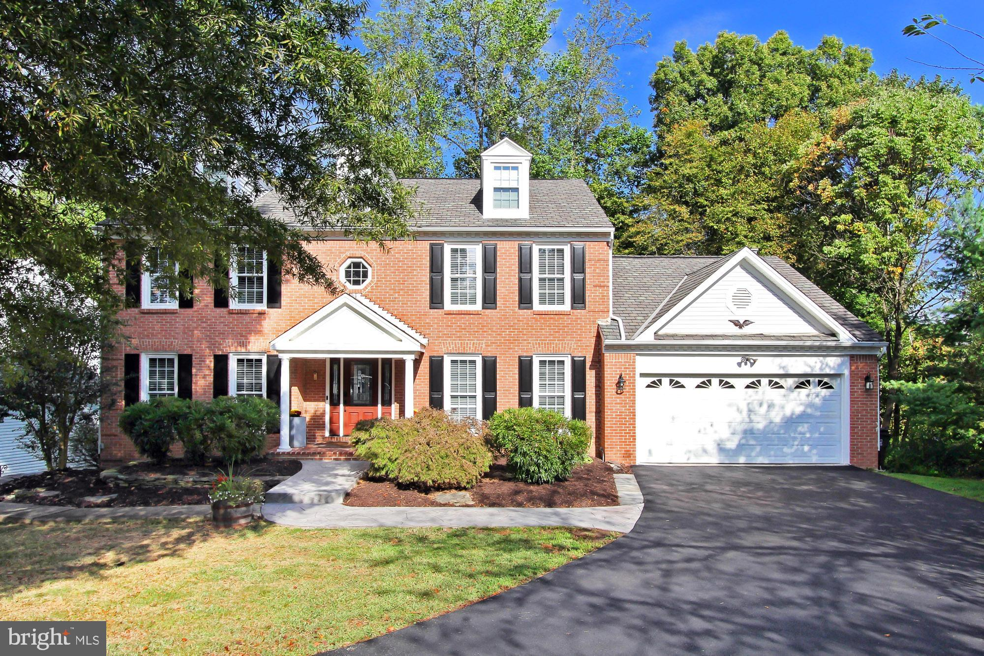 "Welcome Home to this stately brick 4 BR / 2.5 BA Colonial backing to woods! Completely UPDATED from Top to Bottom = MOVE-IN ready! The ""WOW!"" gourmet kitchen, w/ adjoining breakfast area and walk-in pantry, has been remodeled with new cabinets, granite counters and KitchenAid appliances! Two-story foyer, main level office / library! Family Room with vaulted ceiling, skylights, and granite stone gas fireplace.  Gracious Master Suite with updated en suite BA, vaulted ceiling and huge walk-in closet!  Expansive walkout basement w/ full windows, tier media area, space for exercise equipment, and super sized storage room.  NEW deck with stairs to backyard overlooks woods!  EZ stroll to Lake Mercer and close to area parks.  Commuter options include Fairfax County Parkway ("