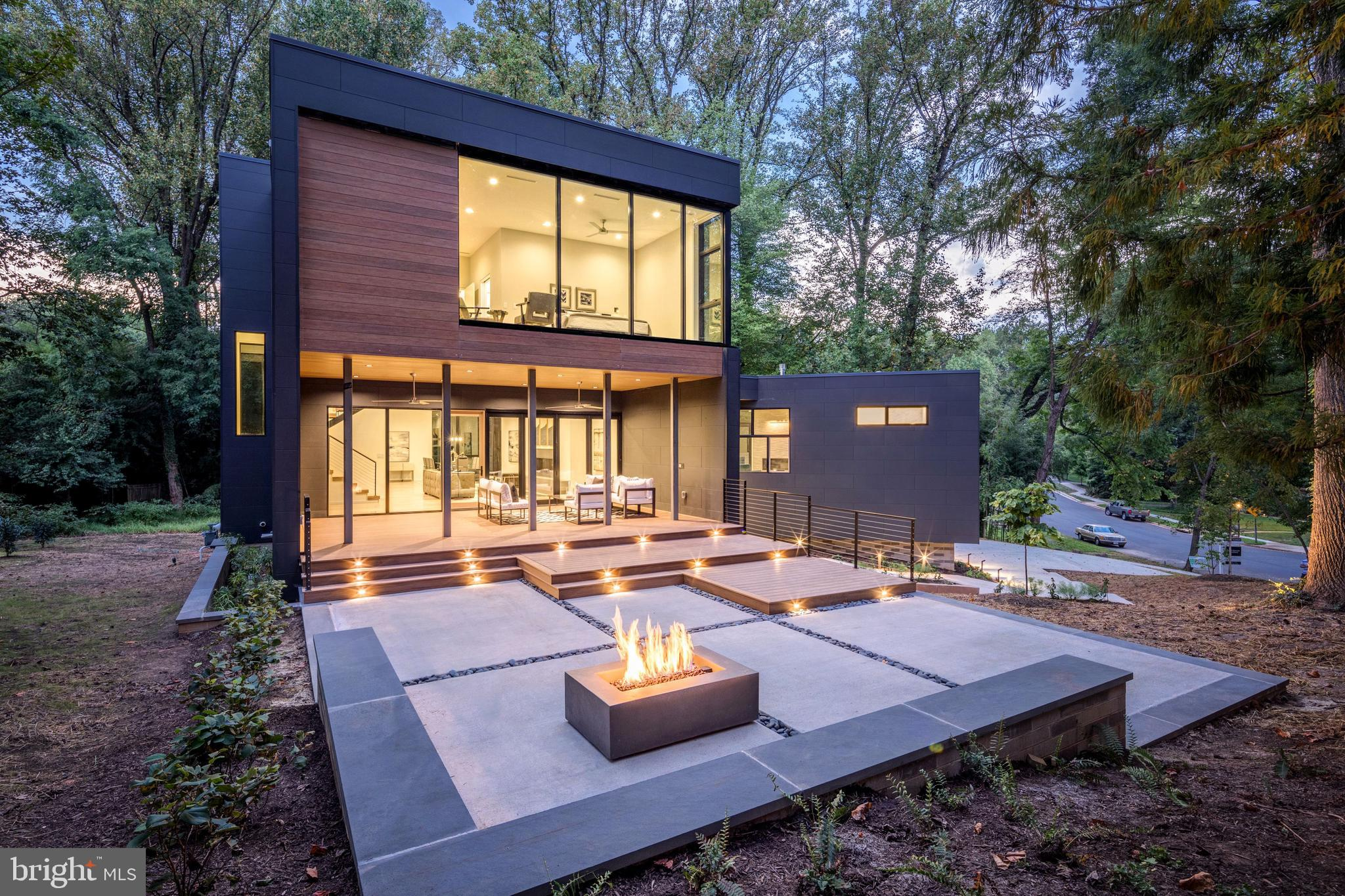Open Sunday Noon - 3pm or by appointment. This custom, modern residence developed by T. White Construction and designed by Studio 27 Architecture is truly a one-of-a-kind masterpiece.  The architecture has been implemented specifically for this secluded, half-acre home site.  Three cascading volumes are oriented to maximize privacy and views of the wooded grounds while expansive windows provide abundant light, blending the experience of indoor and outdoor living.  Finishes and features are of the highest caliber.  The designer kitchen offers Scavolini cabinetry, Miele appliances, & CaesarStone counters.  White oak floors throughout out main and upper levels have been sanded in place.  Elegant bathrooms feature wall-mounted dual-flush Kohler toilets & Duravit vanities.  Multiple outdoor living spaces include a spacious screened-in living room overlooking a patio with fire feature while a floor-to-ceiling folding glass wall opens to interior living area.  10' ceiling heights, optional elevator, over-sized 2-car garage with electric charging pre-wire and a main-level bedroom suite are just a few of the added, unique features of this fine home.