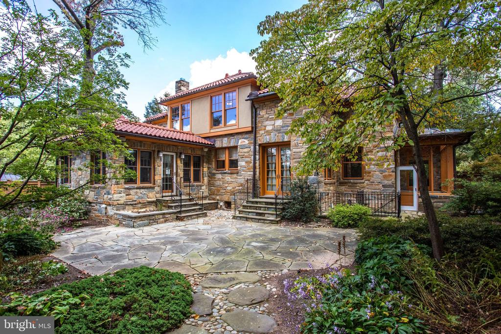 """Recently featured as Washington Post """"Home of the Week."""" this stunning home offers expansive living spaces with gleaming hardwood floors and tons of natural light. The main level features a gourmet kitchen, breakfast room, private office, library and open entertaining spaces including a formal dining room, music room, living room, and sunroom. The second level offers 5 bedrooms plus den or office. The lower level boasts a complete in-law suite with kitchen, bedroom, full bath, living room, and separate outside entrance. Enjoy outdoor living with a covered front porch, solarium, and a fully fenced private yard large enough to accommodate a pool."""
