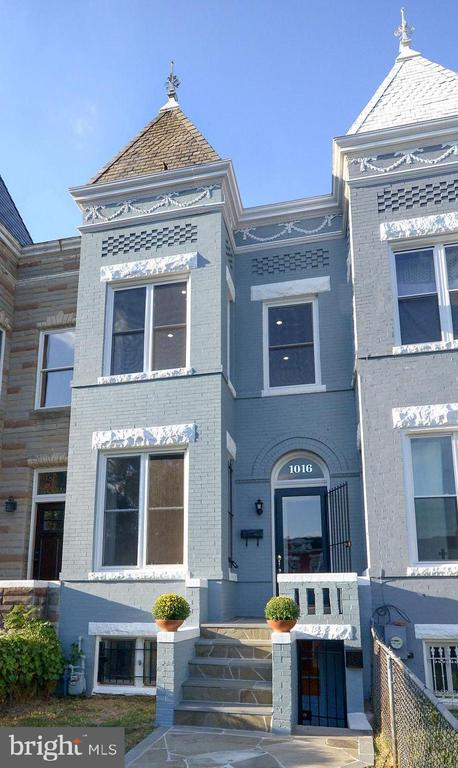 AMAZING PRICE REDUCTION - $969,000; Just steps from the THRIVING shops and restaurants of the H Street corridor and a short stroll to Union Market and Metro, a proud Victorian bay front home recently reborn. DEEP front garden, newly rebuilt stone walkway and pristine slate turret and finial.  Inside a 3 BR and 2 Full + 2 Half BA  welcoming you home! BONUS!!! Dont miss the separate apartment below providing a potential income opportunity. Priceless historic details and knockout kitchen and baths - come see for yourself! Ask us how English basement rent revenue can pay half your mortgage!