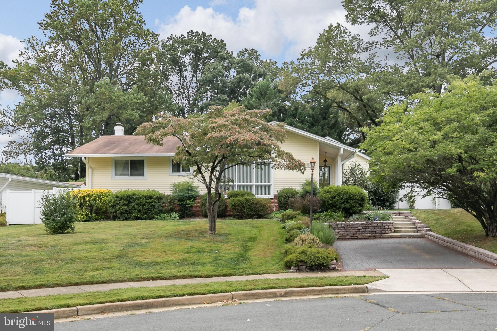 This home has had many updates and upgrades including 2 additions in  2009.  2 zone heating & cooling.  Hardwood flooring throughout the main level.  Spacious master bedroom addition with master bath and walk-in closet.  2nd bedroom has it's own bathroom.  Updated kitchen with high-end cabinets and appliances including a large 5 burner gas cooktop with ss hood, double full sized wall ovens (one is convection).  Family room with gas fireplace (current owners used this as their dining room.  Front living room could be used as a dining room depending on your life style.  Sunroom off the family room.  Large deck is accessible from sunroom & kitchen.  There is a pergola with climbing wisteria.  Extensive landscaping.
