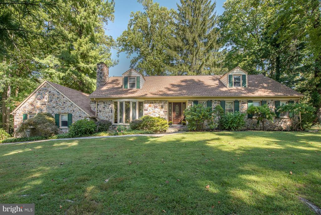 You can have it all with 731 Great Springs Road, Located in North side Bryn Mawr on a prestigious Cul-de-sac Street.  Enter through the Front Door into a Spacious Center Hall featuring Oak Hardwood Floors that follow through the entire home. To the left of the Center Hall you will find a large Great Room/Living Room with Picture Window and Authentic Wood burning Fireplace. The Great Room/Living Room opens to a Beautiful Formal Dining Room, perfect for large family, holiday dinners and gatherings.  An additional picture window overlooks the gorgeous grounds and terraces, including an out-door kitchen area.  The Dining Room has lovely French Doors that lead you out into a charming outdoor Patio.  The Kitchen would delight any chef with it's BlueStar 6-burner range, Theramador range hood, Thermador dishwasher and Sub-Zero Refrigerator. The Kitchen features a Center Island with seating for 3, plenty of cabinetry, Granite Counter Tops and built in Bench Seating for a round table and 3 additional chairs.  Off the Kitchen you will find a cozy, casual Family Room with built- in cabinetry and a Gas Fireplace, Cathedral Ceilings with Beams, Large Pictures Windows that bring the beautiful outdoors inside and French Doors that lead to the Gorgeous grounds outside.  This Level also features 2 elegant Master Bedroom Suites. The Powder Room is located at the beginning of the Hallway, along with a generous Guest closet.   The Master Bedroom, on the left, is complete with a Gas Fireplace and walk-in closet.  Enter into a fantastic ~Spa-like~ Master Bath, which features double glass door enclosed shower with rain forest shower head and hand held shower wand, double vanity and make up area.  The Master On the Right is Large and Spacious with ample closet spaces and a beautiful Bathroom.  The Upper Level features 2 Large Bedrooms and a Lovely Bathroom.  Upon entering the lower level of this property you will find an extra large Family/Recreation room, perfect for a pool table and home 