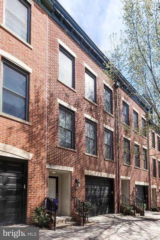 HUGE PRICE IMPROVEMENT! Welcome home to this Upper Fells Point beauty! Built in 2006, this large bright row home has all the perks of city living with none of the the hassles. Nestled on quiet cozy S. Regester Street this home welcomes you in with attached TWO CAR GARAGE parking. Upstairs you'll find an open layout perfect for entertaining and functional for your family's needs. The kitchen has been mindfully updated with stainless appliances and granite counter tops, and opens to bright dining and living area, this floor also features a convenient half bath, and the large windows make it a space you won't want to leave. Third floor hosts two large bedrooms and two full baths, master features walk in closet . Bonus forth level is the icing on the cake! Large lovely bright space with full bath opens to your private balcony! This room has the makings of a master to die for, or office/living space you be inspired in! Don't miss this opportunity! Contact Meighan Sweeney for your private showing 410.279.0087 MeighanMoves@gmail.com