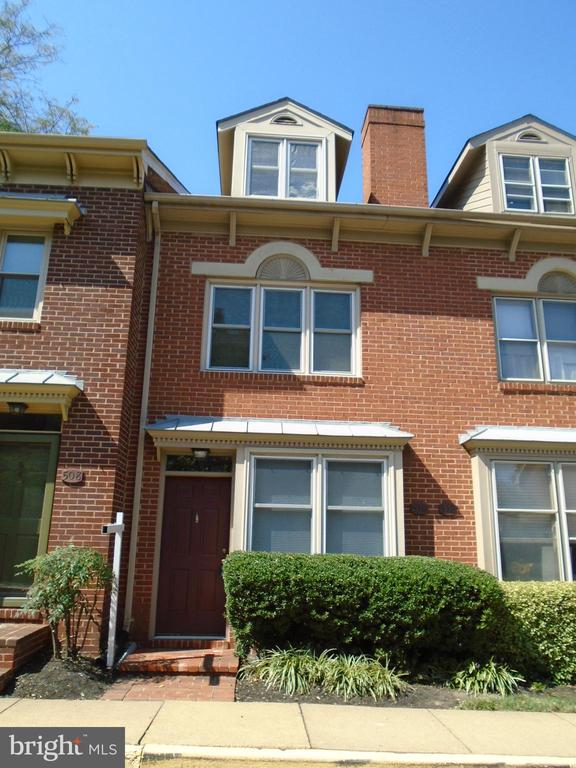 $1800 leasing concession. 4 finished level all brick townhouse 1 BLOCK TO BRADDOCK METRO. Updated kitchen & baths. Wood floors. FRPL. 3 generous bedrooms plus finished basement with 1/2 bath + shower. Assigned parking for 1 + ample street. Pets CBC NMT 2,