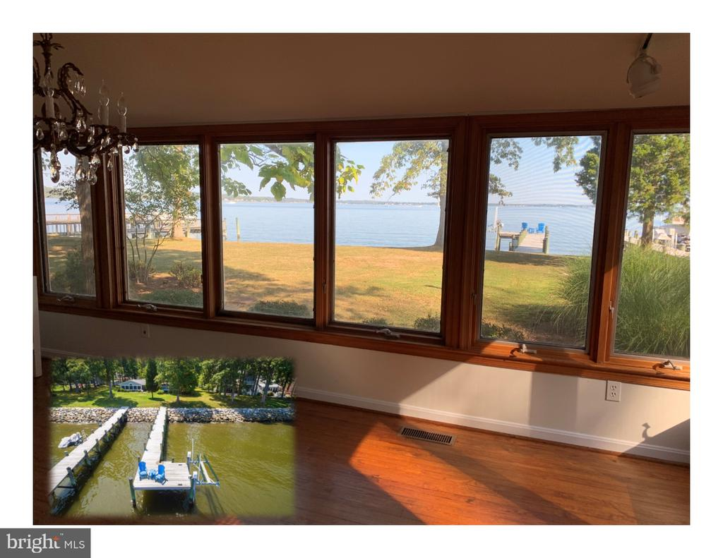"""Welcome to """"Sunshine on the Bay"""" Cottage. A rare original 1930's waterfront home with a private 85' long pier complete with a boat lift, 10' x 20' platform and access steps to the water. The dock has electricity and water, too. The two-story, 3 B, 1-1/2 BA Cottage has been lovingly upgraded and modernized to keep its vintage charm intact with a panoramic wall of Pella and Dormer windows downstairs and open floor plan allowing you to enjoy the waterfront view all the way from the front to the back of the house. The upstairs bedroom overlooks the Bay, too has Dormer windows as well to capture that lovely cross breeze. And you won't miss a sunrise or sunset, the unique positioning of the Cottage along the prime Holland Point stretch gives you a front row seat every day to Mother Nature's most beautiful light show. A built in Napoleon wood burning fireplace and original hardwood floors in the great room and kitchen elevate this home's charm. The property also features a separate large storage garage, emergency generator and propane tank, and deep-fresh water well. The getaway cottage is nestled in a park-like lawn setting with well-placed trees and is situated next to a 50' unimproved private R/W giving added privacy. The award-winning marina - Herrington Harbor South - is within a short walking distance and also can easily be reached in minutes by water from the home's dock. This cottage is a dream location for watercraft lovers. And if you like to fish and crab, this dock is a winning spot, too. """"Sunshine on the Bay"""" is a only a 50-minute drive from DC in the sweet little town of North Beach, MD (in Anne Arundel County -right next to Rose Haven and near Friendship) with its restaurants, wine bars, coffee shops, summertime music, entertainment and street fairs. You may want to expand the upstairs bedroom and increase the views, but this is all set up for future expansion on the upper level . Two car garage SIZE storage unit gives you lots of options for your storage ne"""