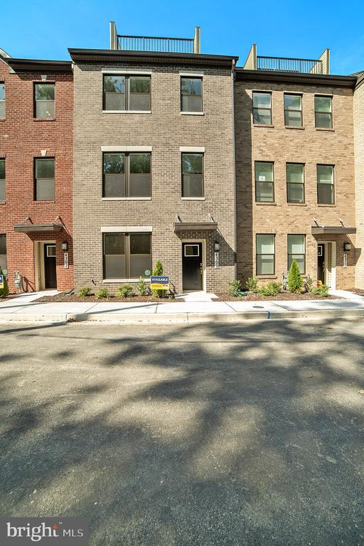 QUICK MOVE IN! Wooded views at The Residence at Roland Heights is Baltimore's newest and most exciting new home community. Walking distance to the avenue at Hampden and Union Collective, and only Minutes to Woodbury, Roland Park, John Hopkins, Loyola, The Baltimore Zoo and the inner harbor. The Community is situated directly off I-83 and is a commuter~s dream. Tie together the best of both worlds with new home construction, a home warranty for peace of mind, Baltimore City living, and the versatility of being close to all your favorite shops, restaurants and bars. Explore Historic Baltimore while also living in a modern, smart home integrated luxury townhome. Homes in this community feature Full Brick Front Elevations, Smart Home Tech Package, Large Quartz Island, rear deck, Luxury Plank flooring on lower and Main level, Oak Staircase with iron spindles, Gas Stainless Steel Appliances. Homes offer optional 4th level loft with rooftop deck so you can make the most out of your space.