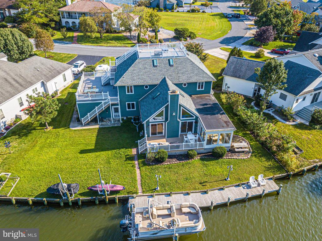 REDUCED!! Boat lover and fisherman's dream!!Sellers motivated!! Have a large crew? This is the waterfront home for you! Located in Wood Duck Isle, waterfront community in Ocean Pines.Directly on the water with a boat lift and 2 jet ski lifts!! Lots of waterfront on this lot with extra room for another boat, crab pots, fishing etc. Ocean Pines association maintains the bukhead and this is included in your HOA fee!!!The home features 5 Bedrooms ,3rd floor bonus room with and 3 full baths with a den. 3rd floor could be bonus 6th bedroom! 1st floor master suite with in suite huge totally updated master bath with huge shower and soaking tub. Like walking into a rain forest, with two walk in closets!! 1st floor also features 2 more nice sized bedrooms and a second updated full bath, huge eat in kitchen with granite counter tops and stainless steel appliances. Very nice and open floor plan with huge living area featuring cathedral ceilings, pellet stove for the cold winter nights and beautiful water views!! As an added bonus there is huge 3 season room off the kitchen with water views. Walk right out to your large waterfront deck and your boat!! 2nd floor offers 2 more bedrooms and a huge completely updated full bath, huge open great room with a custom made bar for all your entertaining. Great space for watching all the games and plenty of room to add what ever you want!! Walk out the second floor to a huge 2nd level and roof top decks with unbelievable views all around!! Also on the 2nd floor there is an office/den space!!! On the 3rd floor there is another nice room with remote skylights!! Recent upgrades and improvements are too many to list but include new roof with 30 year shingles, new garage door opener and garage door, new dock 2 years ago, both hvac units replaced with high efficiency units, 400 amp electrical service and 2 new panel boxes, all re modeled baths, granite, new floors and back splash in the kitchen and the list goes on!!! This is a must see waterfron