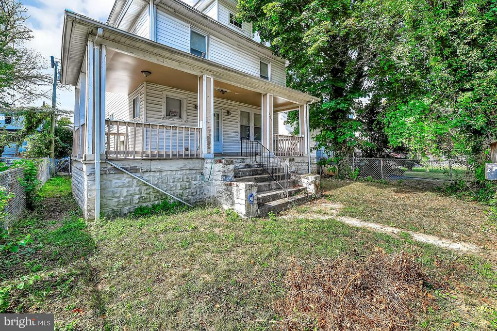 Well-maintained in Baltimore's Woodmere neighborhood! Move in ready & priced to sell. Open floor plan with kitchen, living and dining room, and half bath.  Upper level with four bedrooms and full bath, lower level with half bath. Rear deck and patio. Ask us about possible renovations!