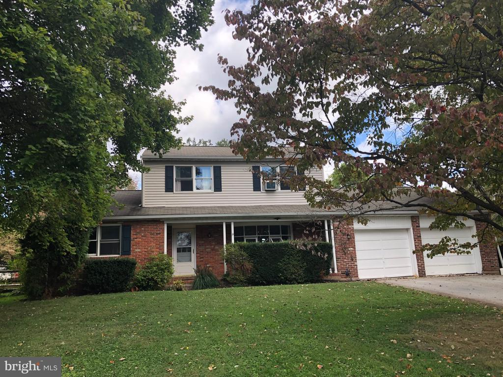 This East Vincent country yet convenient custom built colonial has been lovingly maintained by longtime owners. Covered front porch providing access to the over sized two car garage. The center hall entryway offers newer Pergo flooring.  Living room and dining room with original hardwood floor. The living room has a large bow window. Eat in kitchen with breakfast counter. Large family room with new carpeting and brick wood burning fireplace. The main level also offers a powder room. Upstairs offers 4 bedrooms all with original, good condition hardwood floors, full hallway bathroom.All windows,except bow window in living room are double hung,tilt-in,replacement windows. Full basement with semi-finished rec room  and large utility/ storage room.   Large fenced in back yard. Low traffic community only minutes to Rt 724 and 23.