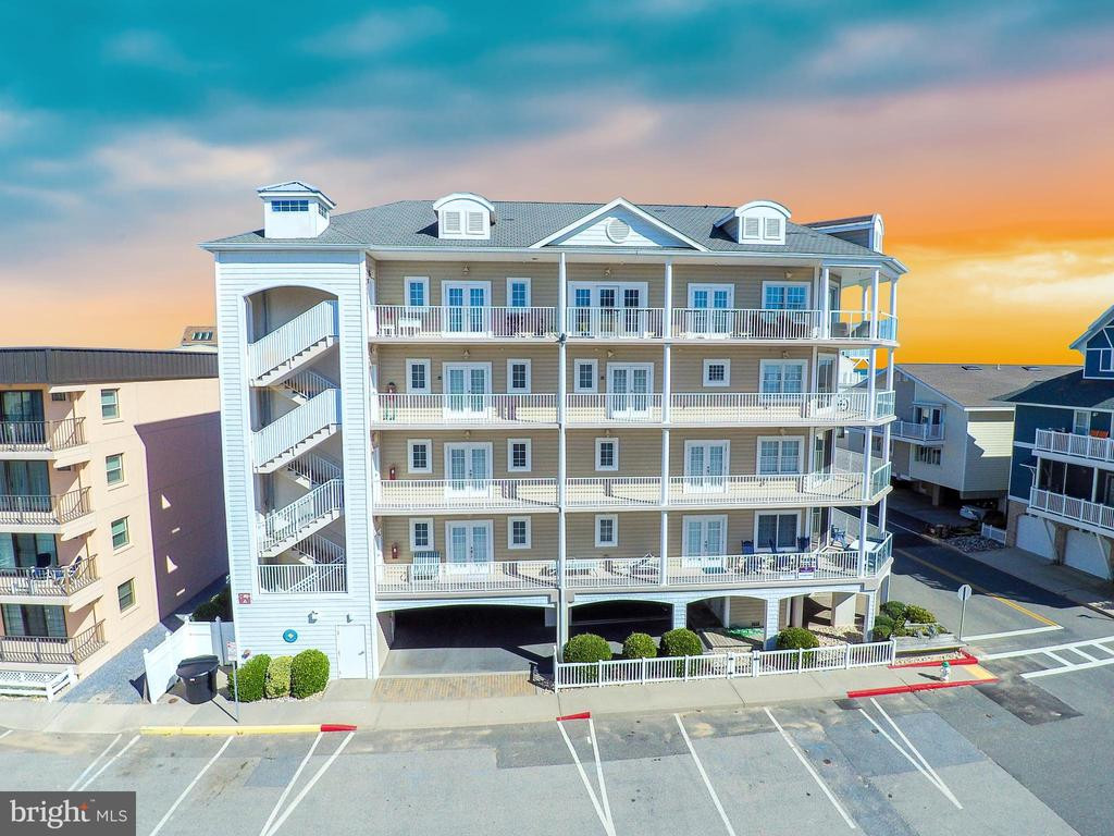 Luxury at it's finest!  Presenting a unique one-of-a-kind North Ocean City 3000+ sq foot two-story ocean-view dream home.  Spacious two-story living in an open floorplan featuring an expansive wrap-around balcony, and endless windows.   There's room for everyone to enjoy, with 4 separate master-suites, all offering stunning oversized fully tiled bathrooms.   Let the chef in the family take over in this gourmet kitchen, while the rest of the crew spreads out in the oversized living room (offering mesmerizing ocean views), or in the private 1st floor den, located near the grand two-story staircase.    No attention to detail has been missed, whether it's the 5 panel doors, the hardwood floors under-foot, the private/secure elevator lobby, the angled living room with glass railings, or the meticulous detail that went into creating such a captivating floorplan.    There's simply no other property in Ocean City like this one.   Corner lot location provides unobstructed ocean views in one of Ocean City's best neighborhoods.   Schedule your private showing, call the listing agent today.