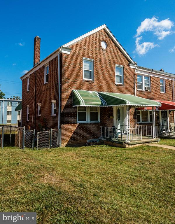 Welcome home - -to this all brick, end of group    town house in the Callaway-Garrison neighborhood.  Updated kitchen with stainless steel appliances.   Hardwood floors throughout with 2 updated  full baths and  3 spacious bedrooms.  Large covered, 2 tiered deck off kitchen.   Perfect for entertaining and grilling. Finished basement with full bath.      Fenced backyard with detached vented garage  just outside the gate.   Garage doors less than 1 year old,  roof less than 6 years old, washer/dryer less than 3 years old,  water heater less than 2 years old, furnace less than 4 years old.  Security system, ceiling fans, recessed lighting, flood lights, replacement windows, chair rail