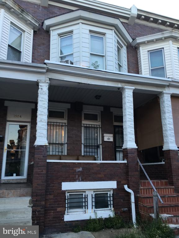 Extremely large rental property ready to do some renovations and rent or sell.  3 bedrooms, 1.5 bathrooms.  Big rooms, parking pad in back.  Porch front.  Not far from Coppin.  As-is.  Grab it up while you can.