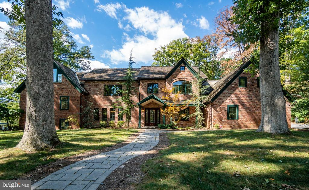 One of a kind, custom built 5 bedroom, 4.5 bath brick home on one of the largest lots in the Town of Vienna. An entertainers dream with an Embassy sized dining room and space to host over 100 of your closest friends! This home cannot be replicated for less than $2.4 mil. The entire 6,000+ sq ft home has in-floor heating, energy efficient tankless water heating, new HVAC system, cedar shingle roof to last a lifetime, copper gutters and downspouts, whole house audio and future proof 10 Gig smart network. Connect with the natural beauty of the outdoors directly from your family room. Enjoy amazing summer nights with the built-in outdoor gas grill on your private corner lot.