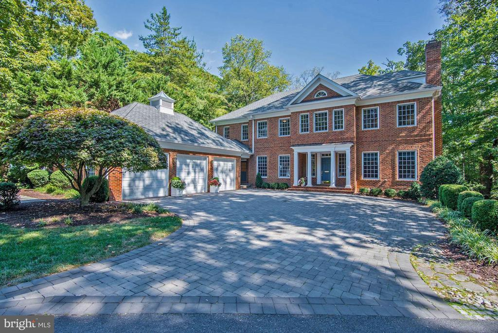 NEW PRICE! JUST REDUCED BELOW ASSESSED VALUE! NEWLY RENOVATED AND UPDATED GOURMET KITCHEN FOR 2020!  This stately, all-brick Colonial in the Kenwood Park neighborhood of Bradley Hills sits on a private 0.65 acre lot (28,503 sq. ft.) and features a sun-drenched floorplan with approximately 6,900 sq. ft. of living space. With 6 bedrooms, 5 full-baths, and 2 half-baths on 4 levels, this immaculate home is complete with high-end finishes, 10 ft. ceilings, 3-car garage, flagstone terraces, and beautifully manicured grounds, all within minutes of Downtown Bethesda. An inviting and spacious driveway leads up to the front door, where a center foyer boasts gleaming hardwood floors, a grand staircase, and is flanked by formal living and dining rooms. Just off of the living room is an office/den with custom built-ins plus recessed lights, and connects to the adjacent family room with walls of windows centered around a stone fireplace that ties the room together perfectly. The newly renovated (2020) gourmet kitchen showcases gleaming hardwood floors, stainless steel appliances, gas cooking, dual ovens, granite counters, subway tile backsplash, large center island, walk-in pantry, and a breakfast area overlooking the backyard. Upstairs you will find 4 bedrooms, including a well-appointed master suite with a fireplace, sun room, custom walk-in closets with immaculate storage and shelving, dressing area, and a resort-like bathroom with dual wings and vanities, connected by a roomy walk-in spa shower. An additional staircase leads up to the top floor of the home, where a bonus bedroom suite can be found. The lower level is fully-finished with a living area/rec room, powder room, bedroom suite with full bath, laundry room, and ample storage. Outside, a 3-car garage is attached through a short breezeway, while the private backyard is highlighted by a flagstone terrace, perfect for outdoor entertaining and large gatherings. 6911 Radnor lies in the Bradley Hills/Pyle/Whitman school dis
