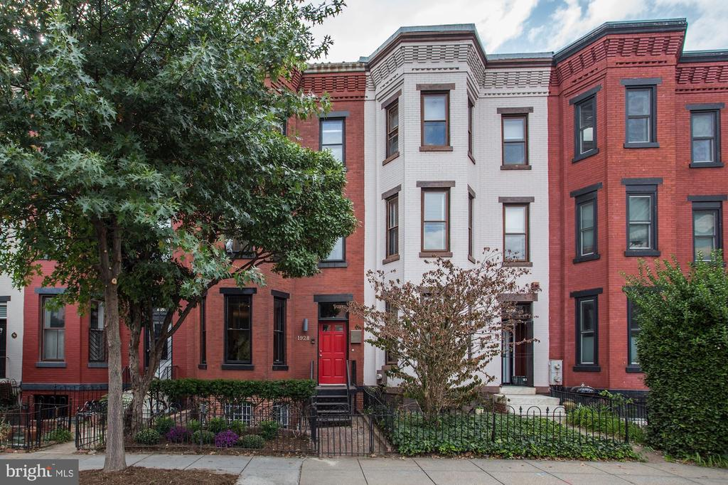 Large 5 bedroom 4 Level Logan Circle Townhouse with in law suite parking and garden. Features include: original detail, hardwood floors, wood burning fireplace, gourmet kitchen, 10+ ft ceiling height, outdoor space, and parking for one car.
