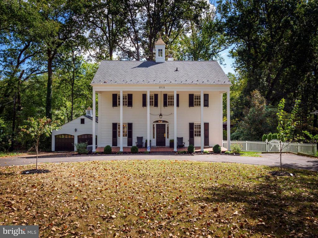 THIS CLASSIC SOUTHERN COLONIAL ORIGINALLY BUILT IN 1939 AND RECENTLY RENOVATED IN 2019 EXUDES CHARM AND WARMTH. SET BACK ON A DEEP LOT AND APPROACHED BY A CIRCULAR, FENCED DRIVE, THE FRONT PORCH, COLUMNS AND CUPOLA ATOP THE MAIN HOUSE INTRODUCE A HOME THAT COMBINES PERIOD DETAILS WITH MODERN AMENITIES, INCLUDING RENOVATED KITCHEN WITH STAINLESS STEEL APPLIANCES AND ON TREND HARDWARE, FIVE BEDROOMS, UPDATED BATHS AND REMODELED LOWER LEVEL WITH ADDITIONAL FULL BATH. THE MAIN LEVEL HAS GRACIOUSLY-SIZED LIVING ROOM WITH FRENCH DOORS AND DINING ROOM WITH ABUNDANT NATURAL LIGHT, PEGGED, RANDOM-WIDTH HARDWOOD FLOORS AND LOVELY BUILT-IN CABINETRY. A BREAKFAST ROOM/SUNROOM OFF THE KITCHEN OVERLOOKS A LARGE, FLAT REAR GARDEN WITH MATURE TREES AND PLANTINGS. THERE ARE THREE BEDROOMS ON THE UPPER LEVEL AND TWO ADDITIONAL BEDROOMS/OFFICE SPACES ON UPPER LEVEL 2. A DETACHED TWO CAR GARAGE IN ADDITION TO THE CIRCULAR DRIVEWAY ALLOW FOR AMPLE PARKING. THE ADJOINING LOT (LOT P1 BLK 5) 6919 AYR LANE BETHESDA, MD 20817 IS INCLUDED IN THE SALE. CONVENIENTLY-LOCATED WITH EASY ACCESS TO CLARA BARTON PARKWAY, MACARTHUR BLVD AND 495. THIS LOVELY HOME COMBINES QUALITY CONSTRUCTION AND HISTORIC CHARM WITH A MODERN CONVENIENCES AND A WONDERFUL LOCATION.