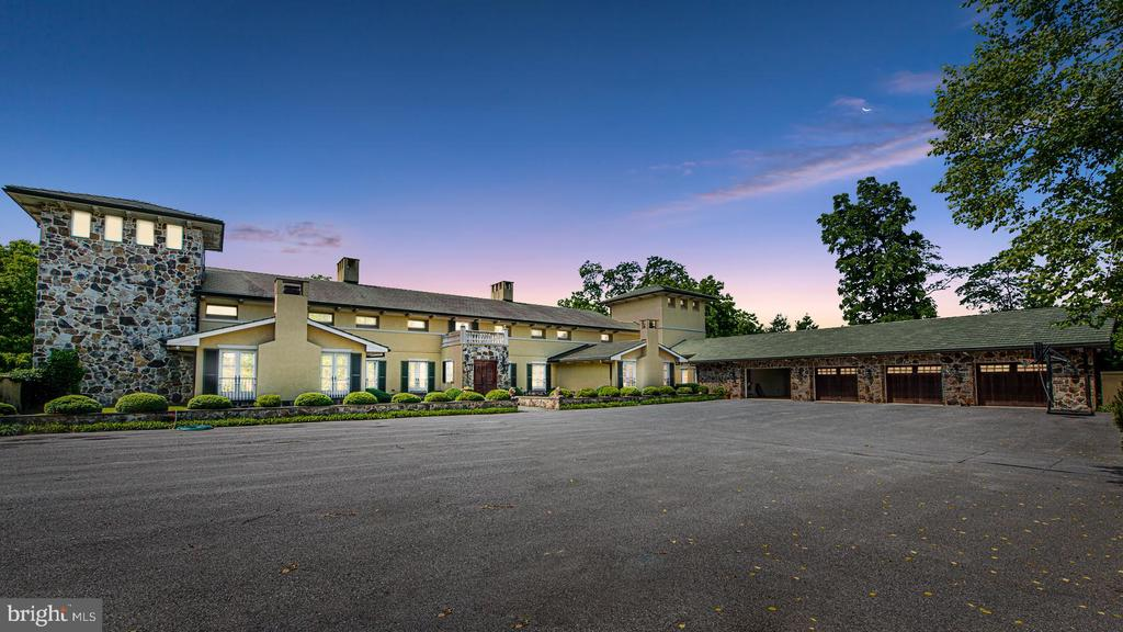 A true Tuscan architectural masterpiece on 70+ tax friendly acres! This opulent home is one of a kind with 4 full bedrooms and 8 total bathrooms, boasting over 11,000 sqft enclosed by private gate and security wall! An entertainers dream! Seamless indoor & outdoor entertaining possibilities with a heated saltwater pool and luxurious loggia. Gourmet Chef's kitchen with upscale appliances, over sized island, exotic granite countertops, adjacent bar and butlers pantry opening to massive 2 story great room equipped with rustic exposed beams and private balconies. Owners main level suite with endowed with 3 HUGE walk in closets with a washer and dryer, lavish owners spa with dual sinks, showers, shower closets, and a massive jetted tub with a view of the expansive green landscape. Upper level has 3 private full bedrooms with attached ensuite full bathrooms, and walk out balcony for each room! Take the elevator downstairs to the sprawling finished basement with separate full exercise room, theatre and game room, possible in law suite, and 2-story incredible wine cellar. Main level also consists of solarium, office, formal dining, 3 car secure garage with laundry and pet grooming area, and much more! Countless possibilities with 40+ wide open acres next door of conservation tax friendly land! Truly a home you must see to believe!