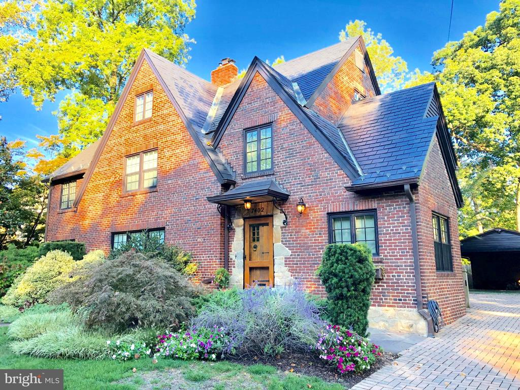 ***Open Sunday, Feb 9th, 2-4pm!*** Exceptional NEW price!  Experience the masterful luxury & elegant design in this recently restored Tudor Revival Style residence.  This one-of-a-kind, four level home is designed with attention to detail & crafted with an abundance of fine finishes that offer elegance and modern comfort.  Its sophisticated design was carefully selected to honor the original architecture along with embracing the exceptional outdoor spaces.  Its beautiful design is evidenced by distinctive ceiling moldings with raised relief squares, fifty-two, historically accurate, casement windows & doors (by Marvin) that frame exceptional views of the grounds coupled with an inviting floor plan that is perfect for entertaining.  The top-of-the-line culinary kitchen is equipped with premium finishes and professional appliances.  All bedrooms feature en-suite baths, and welcomed natural lighting.  Enjoy the magical expansive rear gardens complete with a vaulted ceiling screened-in porch, generous stone patio, grilling pavilion and the convenience of a multi-zone irrigation system.  Drive up on the cobblestone paver driveway to the two-car carport (with attached storage compartment) with additional space on the driveway to accommodate 2 vehicles.  Located on the grand and picturesque Meadow Lane, the home stands proudly within professionally landscaped, lush grounds on a prime and scenic 10,700+ square foot lot. ***Note: In the event further expansion to the residence is desired, the deep, wide glorious lot affords great flexibility for a myriad of possibilities!!***.  This is your invitation to enjoy all the amenities of the sought-after Town of Chevy Chase, the close proximity of the vibrance of downtown Bethesda, the Bethesda Metro, theatre, award-winning B-CC schools, parks, trails, and the convenience to all three major airports and highways.