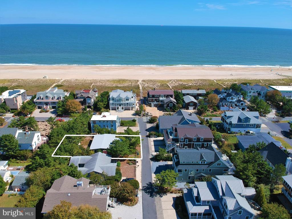 Just 2 homes from the oceanfront, this charming beach cottage is positioned on an exceptional 65 x110 lot with the potential for ocean views in the highly desirable community of Sussex Shores.  Enjoy easy access to the private lifeguarded beach while being just a short walk to downtown Bethany from this quiet street in the southern part of the community. This charming beach retreat has been meticulously maintained and is tastefully furnished.  Offering a welcoming sunroom, bright living room with exposed beams on the ceiling, wood-burning fireplace and 3 bedrooms plus 2 full bathrooms.  An over-sized detached shed provides plenty of space for storing all your beach necessities.  Enjoy this casual beach get away as-is or build your custom dream home in this premier location!