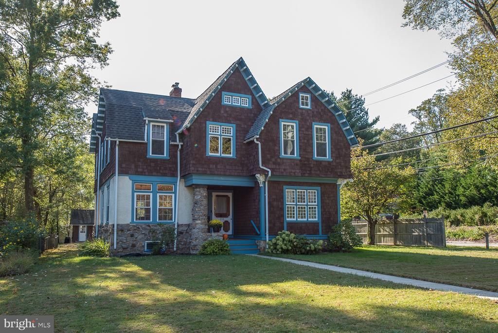 This wonderful Historic Queen Anne Victorian 5 Bedroom home located in the desirable North Wayne Community within walking distance to downtown Wayne will check all of your boxes.  Sidewalks ~ check, tree-lined streets ~ check, walk to town ~ check, community events ~ check! This lovely home features hand-carved gargoyles on the exterior, front entry foyer with golden oak staircase & carved post. The Large Living Room offers a wood-burning fireplace & double doors to a covered back porch.  You enter the Formal Dining Room from the hallway which leads to a large Eat-In Kitchen with New Floor, a pantry & closet and access to the Mud/Laundry Room complete with a closet & utility sink & an outside covered back porch. There is also a cozy downstairs Den on this level & a Powder Room finishes off the space.  There are 2 sets of stairs leading to the spacious 2nd floor.  This level includes 5 Bedrooms, 2 Full Baths, a large upstairs Family Room with Entertainment Center & a private glass door Office.  Some of the wonderful features of this home include 5 antique chandeliers, custom shelving in bedrooms, oak & heart pine hardwood floors throughout, front & back mahogany porches, a large 1500 square foot Basement with an outside (interior & storm glass door) egress, & a large walk-up Attic which is perfect for storage. The home is wired for Power/Phone/Internet/Wifi/Cable TV & offers ceiling fans throughout.  The detached oversized 2 car garage has driveway space for 4 cars.  This beautiful move-in ready home is conveniently located within walking distance to downtown Wayne with its restaurants, movie theater, library, train station, shops & playgrounds. All of this in the award-winning RADNOR SCHOOL DISTRICT! A wonderful place to call home!