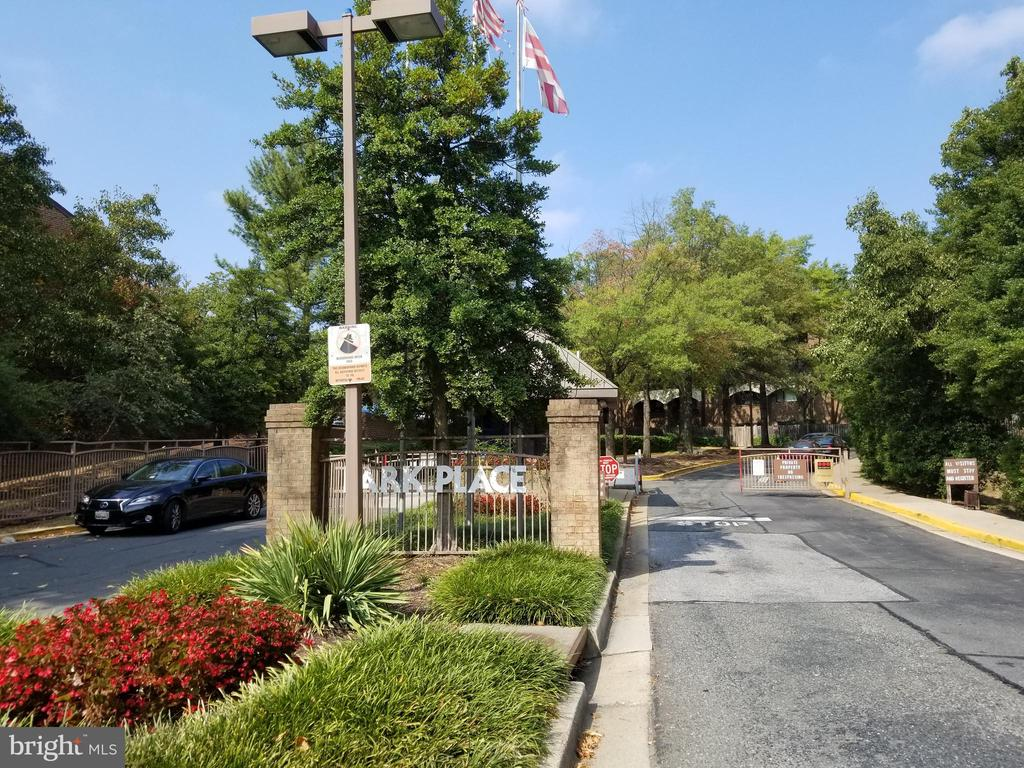 Price adjustment on this rarely available 2BR/1.5 BA 1200 sq ft condo. It's located in a conveniently located gated community with outdoor pool and garage parking.  Unit needs renovating but well worth the effort.  Features include separate dining room with pass-thru, living room with masonry fireplace and      slider to fenced rear yard. Garage parking space 36.