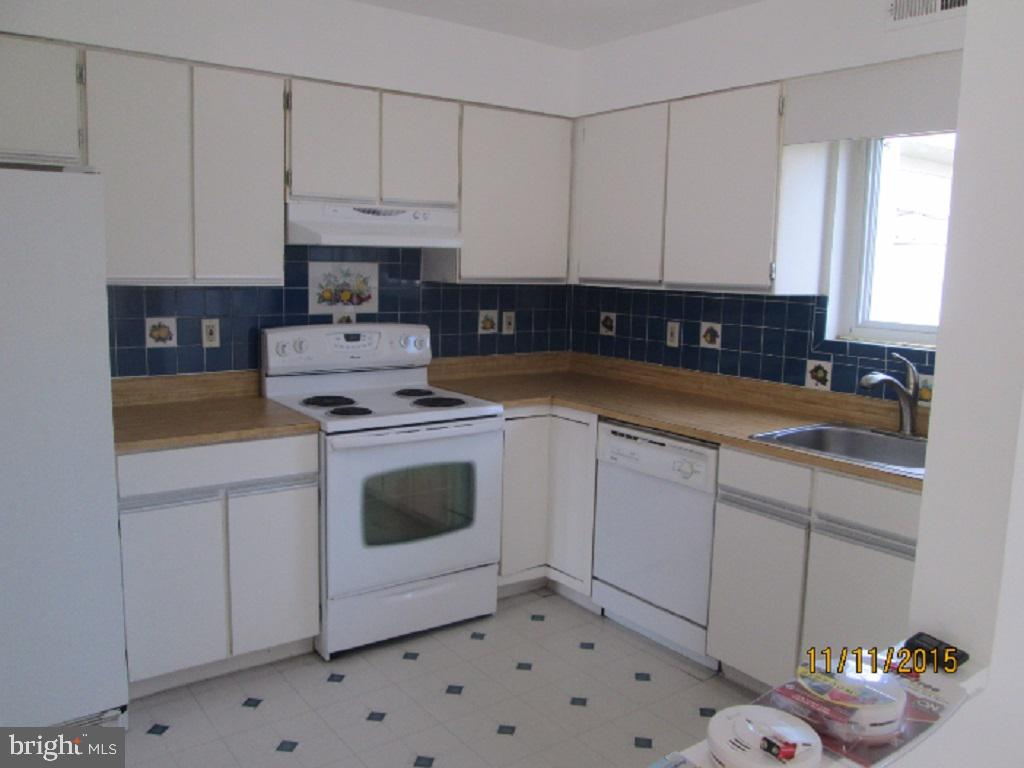 Unique 2BR Den 2BA in Pikesville: Rarely available 2nd floor 2 den condo in upper Park Heights area. Enter into your garage without leaving the building. Relax on your private balcony with over 300 square ft. and is equipped with built-in storage compartments to hide away grill or lounge chairs. The living room is quite spacious with a fireplace. Light wood color laminate flooring throughout the home. There are many great uses for the den area such as entertaining, home office, library or exercise room. The kitchen includes ample appliances, pantry, and view to outside. The bedrooms are large enough for a queen or a king-size bed. The master bedroom tons of closet space. Call today to schedule a viewing. This one will go fast, DON'T MISS IT!