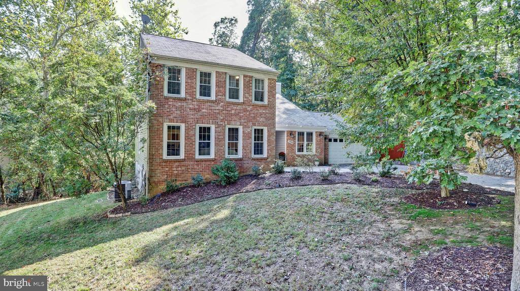 This exquisite 5 BR   3.5 BA colonial is located in the sought after Burning Tree Estates. The high end renovated eat-in-kitchen was designed with the chef in mind! Gorgeous quartz island, Jenn-Air wall oven, NEW cooktop & Kenmore dishwasher, has direct sight to the family room. Home has been freshly painted & upstairs bedrooms have new carpet. Master suite offers a sunlit sitting area, two walk-in closets, full bath with newly glazed tub! Finished lower level includes a newly carpeted recreation room with wet bar, new sliding doors, 5th bedroom, study, full bath and storage room. Nestled on a tranquil quiet cul-de-sac, you will enjoy an outdoor space that includes a renovated three level deck, parking for up to TEN alongside an amazing stone wall, additional landing space and double car garage. Located in the top ranked Winston Churchill school district. This is the one to call home. A true gem you don't want to miss! **Lower level is a walk out basement with approximately 1,148 sqft.**Information deemed reliable but not guaranteed.