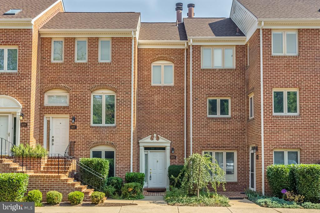 A PROFESSIONALLY MANAGED PROPERTY. Two master suite two-level townhome featuring main level hardwoods, living room fireplace, balcony, private patio, reserved parking and more. Close to Metro, DC, schools, shopping, entertainment and major access routes.  ***Wallpaper is being removed throughout.***
