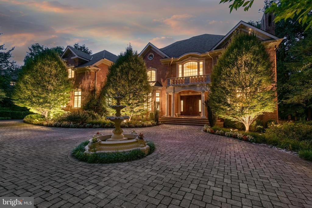 **LISTED UNDER ASSESSED VALUE** - INCREDIBLE All Brick Mansion resting on one of McLean's most sought-after neighborhoods, Langley Forest. 12,000 Sqft on 4 levels nestled on beautiful 1 Acre lot. TOTAL TRANSFORMATION - Freshly painted through-out. Intricate & lavish details are found through-out with 12ft ceilings, finely crafted woodwork, trim, crowns & wainscots. Mahogany hardwood floors. Grand marble foyer with floating curved staircase. Formal living room with gas fireplace & dining room. Author's library with built-ins. 2-story Palladian room with marble flooring. Updated Chef's caliber kitchen includes granite counters, SS appls, pantry, large island & coffee station. The family room with gas fireplace walks out to the deck overlooking the gorgeous yard. Upper level feats master suite with tray ceilings, 3 sided fireplace, ultra bath & huge walk-in closets, plus 4 en-suites. Top floor is perfect for the 6 bedrooms or den with full bath. The lower level is perfect for entertaining with huge rec room, wet bar, club room, theater & 2 bedrooms with full bath or exercise room walking out to the gorgeous patio. 3 car garage with hobby station & grid panels. Area rugs convey.