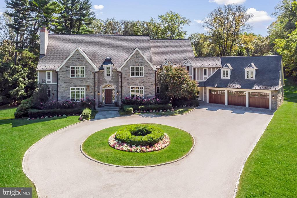 """UPDATE:  Video Tour has been uploaded and private showings will be available by appointment once the Shelter in Place Order has been lifted.  This home is perfectly located in prime Northside Villanova; this gracious custom built Fred Bissinger designed home is set on a private 1.75 acres with access to all conveniences and top schools.  Drive to the end of a private street, where you find this~9500 square foot light filled home with stone and limestone exterior appointments. The circular driveway leads to a fabulous center hall entrance which opens to a formal living room, dining room and quarter-sawn oak office.  Ten foot ceilings with custom millwork and large Pella windows and French doors are featured throughout with an open floor plan.  An exceptional gourmet kitchen has a Calcutta gold marble topped large island, custom tile and grass cloth lined walls, custom floor to ceiling cabinets with 2 36"""" Sub Zero refrigerators with freezer drawers, dual built-in ovens, a 48"""" 6 burner Viking built-in, 2 Bosch dishwashers and a butlers pantry with Sub-Zero wine refrigerator and copper hammered sink.  The mudroom and kitchen all flow into the light filled breakfast room and family room with four sets of French doors leading to an outdoor terrace and large private backyard.  The second level has a large master suite with a sitting room, dressing room with custom built-ins, walk-in closets and a master bath with views overlooking the home's exquisite grounds. An additional 4 bedrooms and 3 baths which includes a large guest suite complete the 2nd floor.  A partially finished third level can be an additional guest suite with bedroom, bath and sitting area.  The stunning and expansive lower level which walks out directly to the lawn offers 2 sitting areas, 9+ foot ceilings, custom wainscot and millwork, hardwood floors, a powder room, modern exercise room, a full bar with high end appliances and a beautiful temperature-controlled wine cellar.  Six zones of central heating a"""
