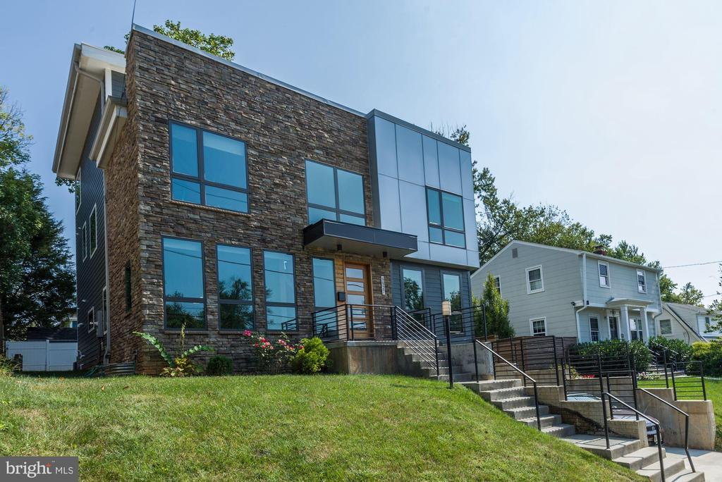 Distinct. Modern. Luxury. Imagine living in a modern urban masterpiece, yet perfectly settled near the best of suburban Bethesda. Welcome to 9927 Dickens Avenue - a six bedroom, five full bat custom- built home designed for the 2019 homebuyer! From soaring 17 foot ceilings to over 60 sun soaked glass windows across 4 finished levels, you will not mistake this property for another. Over 5,000 square feet of innovative living with features to include a NanaWall folding glass doors to connect the living room to the yard, a private top floor master suite with perfect unobstructed evening views of the moon and stars, a rooftop deck reminiscent of DC luxury living, 3 individual heating and cooling zones, a fully finished lower level with a kitchen, bedroom, and laundry room, plus much more! From the high-end finishes to open airy layout, this home takes modern-contemporary to the next level! 9927 Dickens Ave is sure to impress the modern urban dweller who is also looking for world class schools, ample shopping, and unbeatable nearby nightlife! If living in style with a Bethesda address is your next move  welcome home!